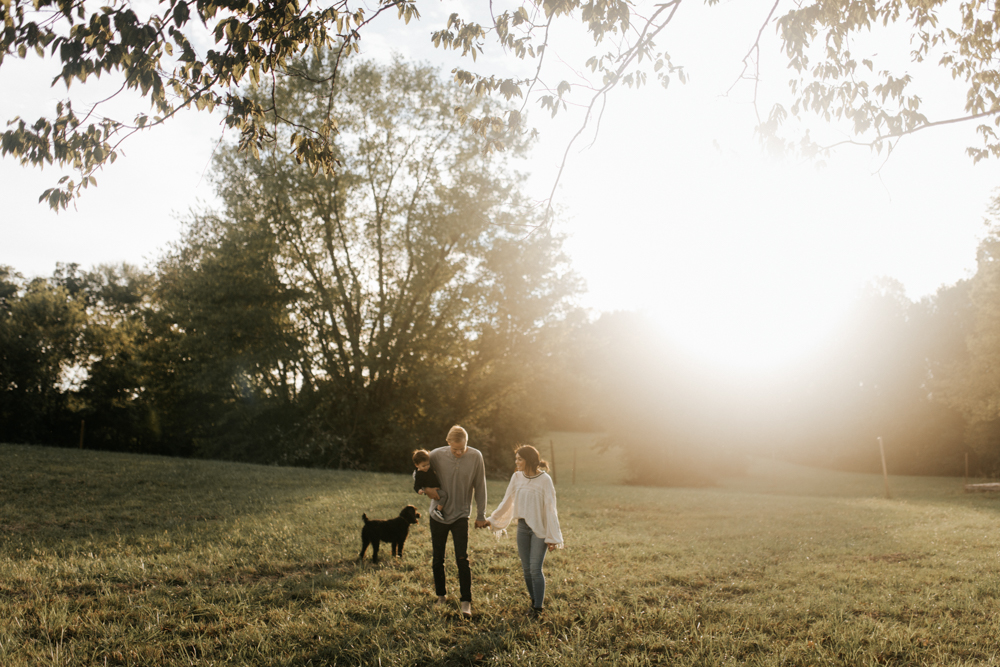 Family of three in a field at sunset in Spring Hill